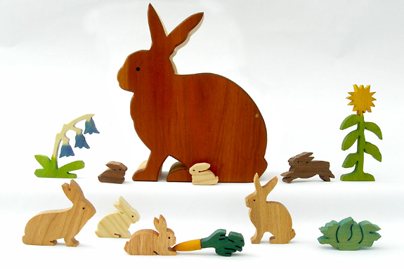 wooden rabbits and plants in a rabbit box